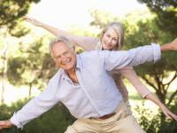 Portrait Of Senior Couple Having Fun In Countryside