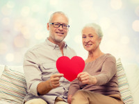 happy senior couple with red heart shape