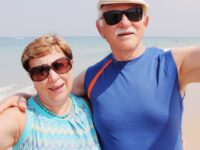 Selfie portrait of senior couple on the beach