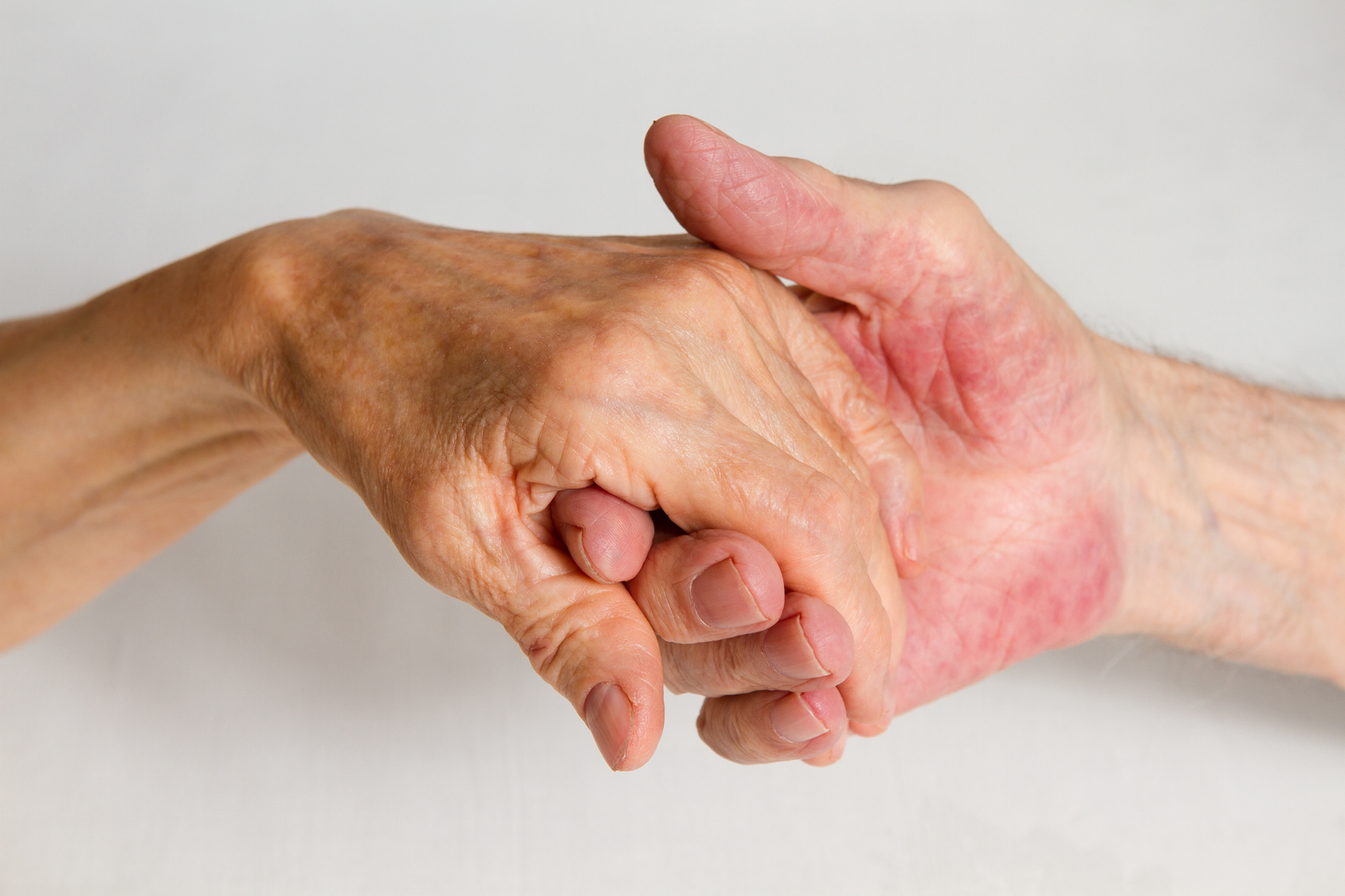 Old people holding hands. Closeup.