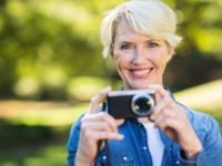 middle aged woman with her camera