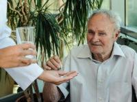 Elderly man takes medication