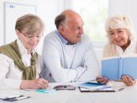 Happy retirees studying