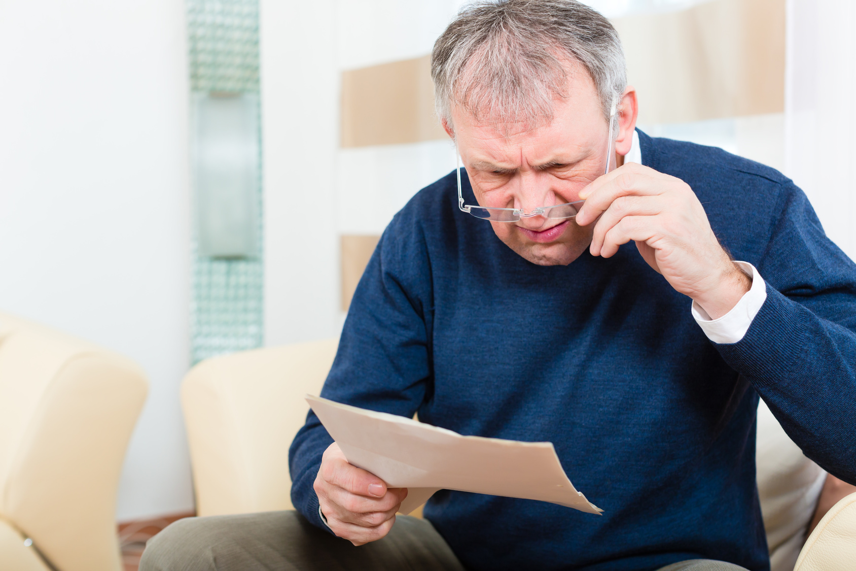 Senior at home receiving negative message