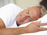Senior Man Asleep In Bed