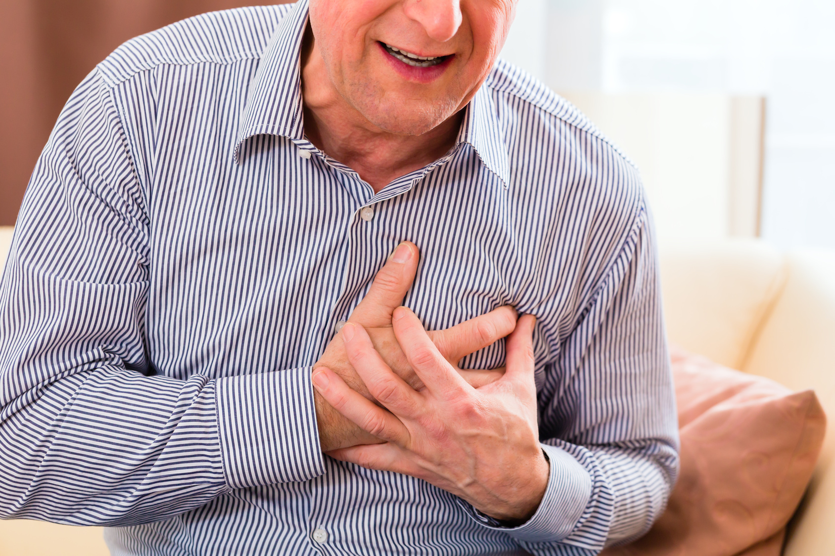 Senior having heart attack at home