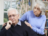 Woman Comforting Senior Man With Depression