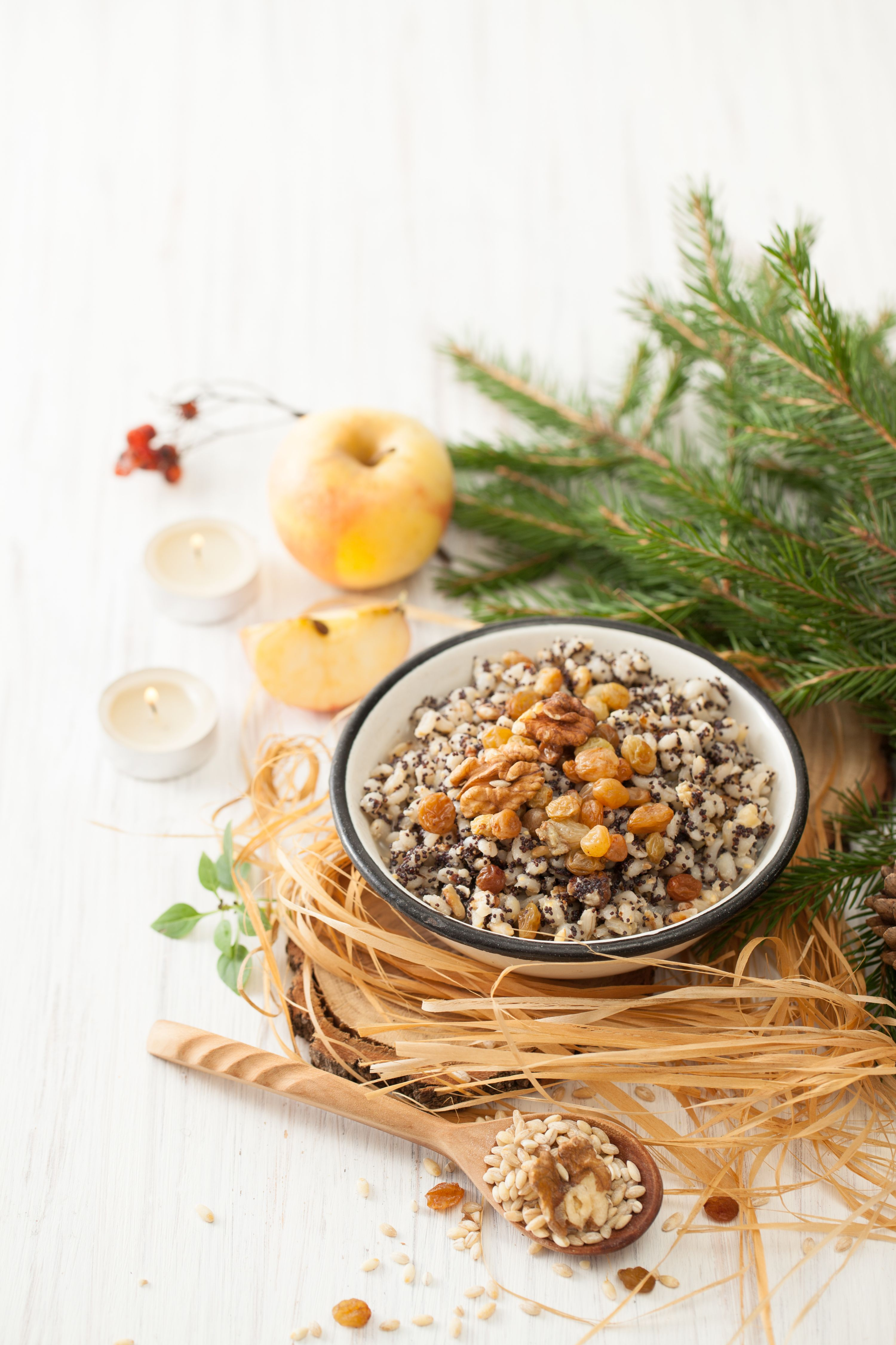 Christmas porridge with a fur-tree branch on a white table